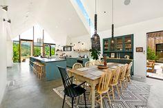 Gravity Home: Blue kitchen in A Modern Farmhouse in California
