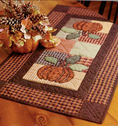 """Harvest Pumpkin"" from Thimbleberries Collection of Classic Quilts by Lynette Jensen. Do you like to decorate your house for all the holidays and seasons? This easy applique table runner says ""I love autumn!"" Find it online: http://landauerpub.com/Thimbleberries-Collection-of-Classic-Quilts-Softcover.html"