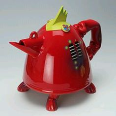 This is a thrown and assembled funky chicken earthenware teapot by Richard Godfrey.