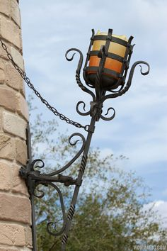 Fantasyland Enchanted Forest castle wall - Photo 17 of 27 Rustic Pendant Lighting, Rustic Wall Sconces, Outdoor Wall Lighting, Outdoor Walls, Lighting Ideas, Porch Light Fixtures, Castle Wall, Candle Chandelier, Gothic Home Decor