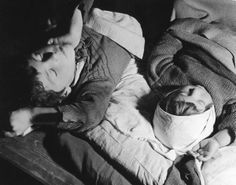 Russian children sleep in a subway station during German air raids on Moscow (1941)