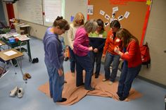 Can your team flip over the blanket just using your feet - and staying on the blanket?