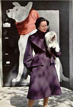 1950 Sylvie Hirsch in violet wool redingote by Robert Piguet,