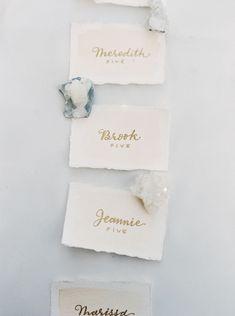 Rock Crystals and Calligraphy Escort Cards | Laura Gordon Photography | See More! http://heyweddinglady.com/raw-gem-geode-wedding-inspiration/