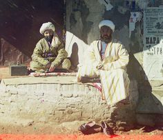 """Trader in the Registan"". Samarkand. Uzbekistan. Photo: Sergey Prokudin-Gorsky Date Photo Taken - 1911. Traditional costume (Ikat textiles)...."