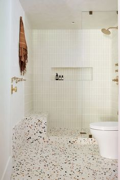 See the Transformation of This Fun Yet Sophisticated Scandinavian-Inspired Bathroom | Architectural Digest White Bathroom Tiles, Bathroom Floor Tiles, Vinyl Panels, Recessed Medicine Cabinet, Shower Fixtures, Fireclay Tile, Colored Ceiling, Floating Vanity, Bath
