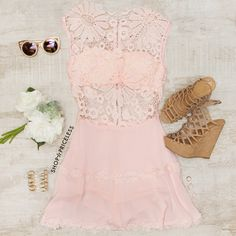 - Details - Size Guide - Model Stats - Contact Girl, go wild for this Lena Flower Lace Dress in blush! Features a lightweight knit and crochet and lace fabric with minimal stretch. High neck front wit