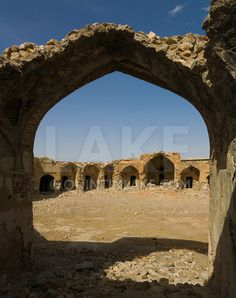 Disused caravanserai on the road from Yazd to Isfahan. The buildings served as a roadside inn for travellers. They provided security and each merchant stayed in one of the identical bays with the square used for animals. Iran.