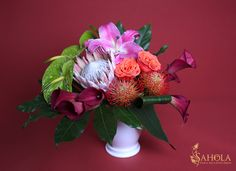 Medium size flower arrangement with a large multi-colored blooms - lilies, pincussions, roses, anthuriums, callas. Terrific and spectacular combination! Bouquet made by New York Floral Designer Sahola. See more beautiful flowers at https://saholany.com/shop/  #bouquets #flowerstagram #saholaflowers