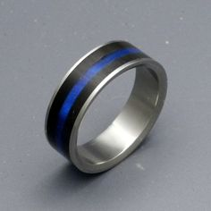 Found this on here, very nice for them!  If Robert and I hadn't designed our matching bands, I would have chosen this one!  Wedding Band. Police Thin Blue Line.