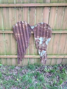 Galvanized steel angel wings, cut out with a jigsaw. Rusty crusty garden art.