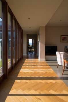 Herringbone oak parquet floor and floor to ceiling windows in new house by McCann Moore Architects Belfast. Oak Parquet Flooring, Floors, Floor To Ceiling Windows, Floor Design, Tiles, New Homes, Stairs, Flooring Ideas, Belfast