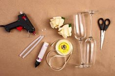 In this tutorial you are going to learn how to decorate wine glasses in an amazing and easy way. They are perfect to be used in romantic dinners, wedding Flower Crafts, Diy Flowers, Flower Decorations, Paper Flowers, Wedding Flutes, Wedding Glasses, Decorated Wine Glasses, Painted Wine Glasses, Bride And Groom Glasses