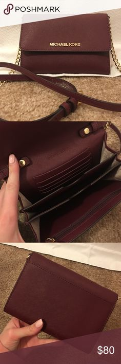 Small cross body Michael Kors purse Small maroon crossbody authentic Michael Kors. Only used a couple times, extremely good condition. Michael Kors Bags Crossbody Bags