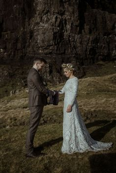 The views of this Isle of Skye elopement are absolutely stunning. | Image by The Caryls Photography Wedding Locations, Wedding Venues, Wedding Blog, Destination Wedding, Tropical Beaches, Old World Charm, City Buildings, Mountain Range, Absolutely Stunning