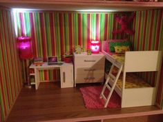 loft bed with desk/bookshelf, three drawres , laptop many books, lights, mattresses with pillows and a blanket,
