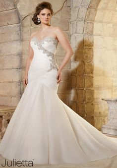 3187 Wedding Gowns Mori Lee. Really beautiful dress, gorgeous on. Structure of the dress gives you an amazing shape. I didn't get it bcuz of the beading under the arms.