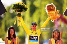 Chris Froome of Great Britain and Team Sky celebrates in the yellow jersey on the podium after overall win following the twenty first stage of the 2015 Tour de France, a 109.5 km stage between Sevres and Paris Champs-Elysees, on July 26, 2015 in Paris, France.