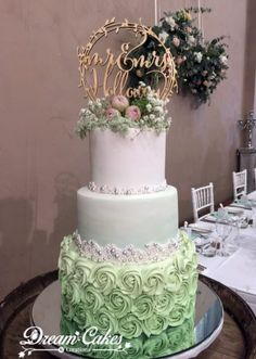 Ombre buttercream rosettes and I love the little touch of fresh flowers in this wedding cake