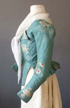 Turquoise silk taffeta brocade caracao (jacket), probably English, 1780's.   That Fabric made into a gown would be amazing!