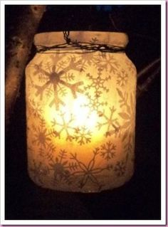 Modge podge white christmas or seasonal tissue paper to make a small jar candle or stick in a vanilla pillar candle.