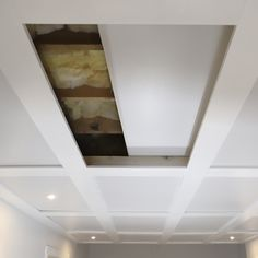 Looking to achieve the functionality of drop ceilings in your basement, but maintain a higher end look? Check out our creation: DIY Coffered Ceilings...with hidden access! #basementideas #renovation #remodel #ceiling #design #finishedbasement #homedecor #beforeandafter #mancave #mediaroom #projects #lighting #budget #hidden #coffered #accesspanel #modern