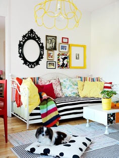 frames, cushions, stripes, wire light shade, dog. happy room.