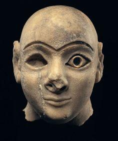 A Sumerian Head of a Worshipper Ca. 2600-2400 B.C.E., H. 10 cm.