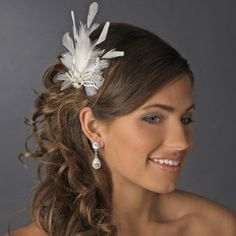 This stunning feather fascinator is the perfect way to add glamor to your classic or modern wedding. Brilliant feathers fan from a rhinestone encrusted silver bow.  Kim's Bridal, Keywords:  #michiganbridalshop #weddingaccessories #kimsbridal Follow Us: http://www.kimsgiftbaskets.com/ ... https://www.facebook.com/KimsGifts