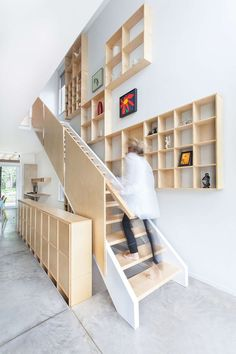DESIGN DETAIL - A Grid Of Plywood Shelves Follow The Stairs