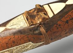 Crossbow of Count Ulrich V of Württemberg (1413–1480) Maker: Attributed to Heinrich Heid von Winterthur (probably Swiss, active Stuttgart, recorded 1453–1460) Date: dated 1460 Geography: probably Stuttgart Culture: German, probably Stuttgart Medium: Wood (European hornbeam), horn, animal sinew, staghorn, birch bark, iron alloy, copper alloy, pigment Dimensions: L. 28 1/16 in. (71.2 cm); W. 25 5/8 in. (65 cm); Wt. 6 lb. 9 oz. (2972 g)