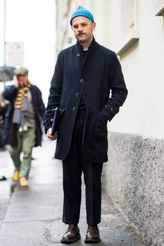 Angelo Flaccavento wears a Barena coat, Moscot glasses and Prada shoes.
