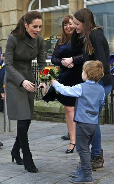 The Duchess of Cambridge received flowers from Theo Hayward, aged three, as she left after visiting a GISDA centre in Caernarfon in Wales on a chilly Friday morning