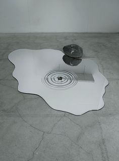 Puddle-Shaped Mirrors Look Just Like Actual Water