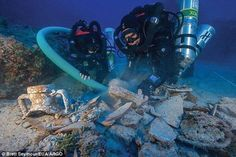 During the latest dive experts spent a total of 40 hours on the sea bed to unearth more than 50 new treasures. These included the remains of a bone flute, a pawn from an ancient board game, fine glassware and a bronze armrest believed to have been part of a throne (pictured) #scubadivingequipmentwetsuit