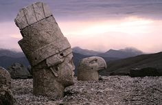 Ancient stone heads of Mount Nemrut, Turkey. In 62 BC, King Antiochus I Theos of Commagene built on the mountain top a tomb-sanctuary flanked by huge statues (8-9 meters high) of himself, two lions, two eagles and various Greek, Armenian and Persian gods, such as Hercules-Vahagn, Zeus-Aramazd or Oromasdes (associated with the Persian god Ahura Mazda the god of Zoroaster), Tyche, and Apollo-Mithras. These statues were once seated, with names of each god inscribed on them. The heads of the…