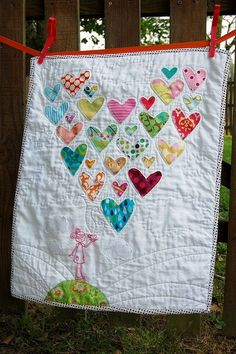 quilt made with baby clothes Not your average t-shirt quilt. I should do something like this for when the kids leave the home... a quilt from fabric swatches of clothes I've made for them.