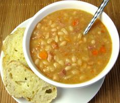 White Bean and Ham Soup  1/2 tbsp olive oil  1/2 yellow sweet onion  1 cup of carrots sliced  2 stalks of celery sliced  1 clove of garlic minced  1 1/2 cups of cooked diced ham  4 14oz cans of white beans or navy beans (rinsed & drained)  3 cups of chicken stock  1 bay leaf  Sea salt and fresh cracked pepper to taste