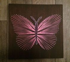 This is a pink string art butterfly that I have made, they are also made to order at the same price so please ask if you would like a different colour.