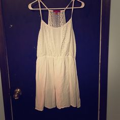 White Dress with Gorgeous Lace Detailing White spaghetti strap dress with lace detailing on the top front and back. Gauze like material. Worn only once for my graduation. Purchased from Wet Seal but brand on the tag is Hot Kiss Wet Seal Dresses Mini