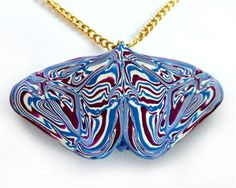 "This is a one-of-a-kind polymer clay butterfly pendant in violet, blue, and white, made using mirror image technique with high quality polymer clay. Approximate pendant dimensions: 2"" wide x 1"" tall, 1/8"" thick. Metric: 5 cm wide x 2 3/4 cm tall x almost 1/2 cm thick. The chain length is 19"" (48 cm), including the long barrel clasp. The chain is gold-tone brass, so it's not appropriate for anyone with metal allergies or with acidic skin that makes base m..."