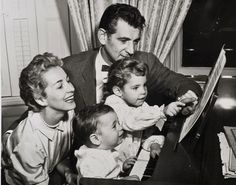 Leonard Bernstein and family at the piano.