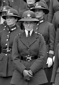 1919 - WW1 London: Female members of the Scotland Yard pose for a group portrait. The London police department was pioneer in recruiting and deploying women in the patrol force.