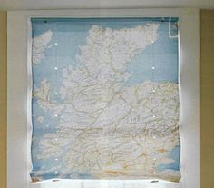 Here's another use for outdated maps: Use as window covering. To make DIY classic window shades (from maps or other material), click through for a tutorial.