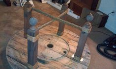 Stair railing balusters were cut down and attached to a large spool