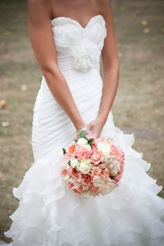 Don't necessarily like all of the flowers but I like the idea of how big the bouquet is!
