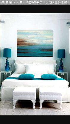 This look but instead of the painting, distressed wood in teal, aqua, and gray all the way up to the ceiling as a headboard.