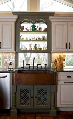 Cooking implements, appliances and storage are also important facets of farmhouse kitchen design. Sinks have a special place in farmhouse kitchen design. The classic farmhouse sink features a deep, wide basin often made of porcelain or stainless steel; Rustic Kitchen Sinks, Kitchen Sink Decor, Copper Farmhouse Sinks, Green Kitchen Cabinets, Kitchen Cabinet Styles, Farmhouse Kitchen Cabinets, Farmhouse Style Kitchen, Kitchen Styling, New Kitchen