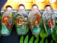 Bright colors vivid images 8 beautiful tiger scenes on 4 bottles. Thick glass bottles. Rare mountain tiger scene. There is no visible defects on any of the bottles. This is from the early 80's the box shows some aging on the bottom with the paper. | eBay!