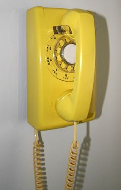 Phones with cords... When we lived in Detroit the phone on the wall in the kitchen had a cord so long mom could go all over the house.  It rolled up in about 3 circles on the floor!